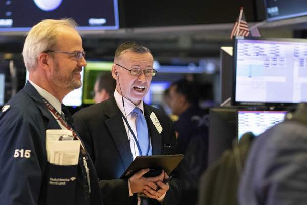 Associated Press Traders work at the New York Stock Exchange on Friday.  The Dow Jones Industrial Average closed 2,000 points higher, its biggest points gain ever.