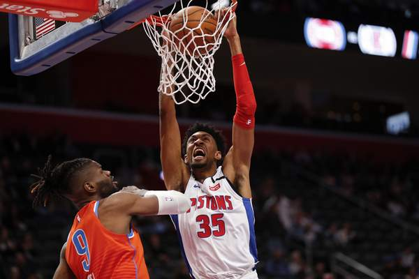 Detroit Pistons forward Christian Wood (35) dunks on Oklahoma City Thunder center Nerlens Noel (9) during the first half of an NBA basketball game in Detroit, Wednesday, March 4, 2020. (AP Photo/Paul Sancya)