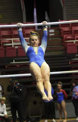 Katie Fyfe | The Journal Gazette  Homestead freshman Gianna Zirille does the uneven parallel bars during the 48th Annual Gymnastics State Finals at Worthen Arenain Muncie on Saturday.