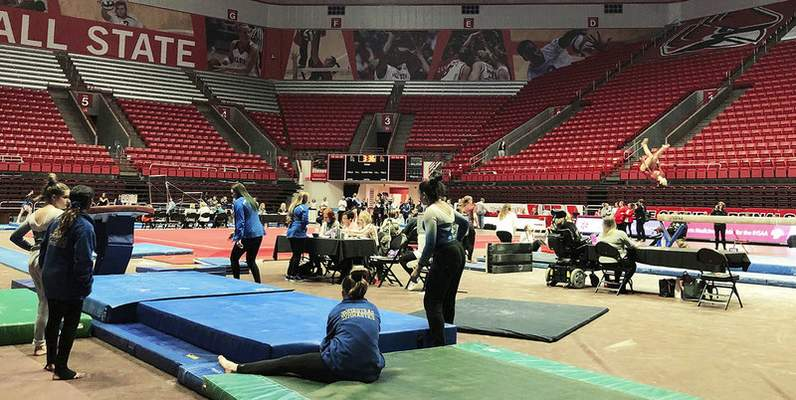 Katie Fyfe | The Journal Gazette  Gymnasts present their routines with no spectators due to the Coronavirus during the 48th Annual Gymnastics State Finals at Worthen Arenain Muncie on Saturday.
