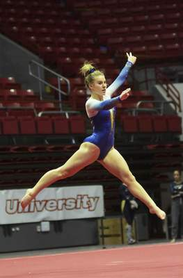 Katie Fyfe | The Journal Gazette  Homestead freshman Gianna Zirille does a floor exercise during the 48th Annual Gymnastics State Finals at Worthen Arenain Muncie on Saturday.
