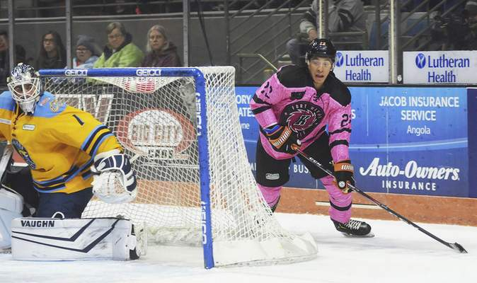 Katie Fyfe | The Journal Gazette  Komets defenseman Max Gottlieb attempts to come around the goal and take a shotagainst the Toledo Walleye at Memorial Coliseum.