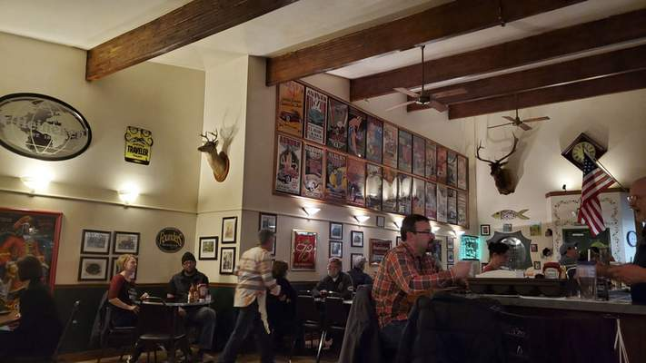 Mounted hunting trophies and ACD Festival posters lift Mimi's Retreat's atmosphere from the normal downtown bar.