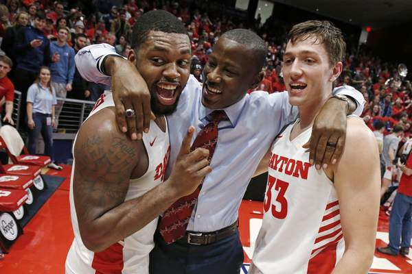 Associated Press Dayton coach Anthony Grant hugs Trey Landers, left, and Ryan Mikesell after a game last month. The Flyers (29-2) were rolling when the NCAA decided to cancel March Madness.