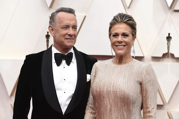 FILE - In this Feb. 9, 2020 file photo, Tom Hanks, left, and Rita Wilson arrive at the Oscars at the Dolby Theatre in Los Angeles. (Photo by Jordan Strauss/Invision/AP, File)