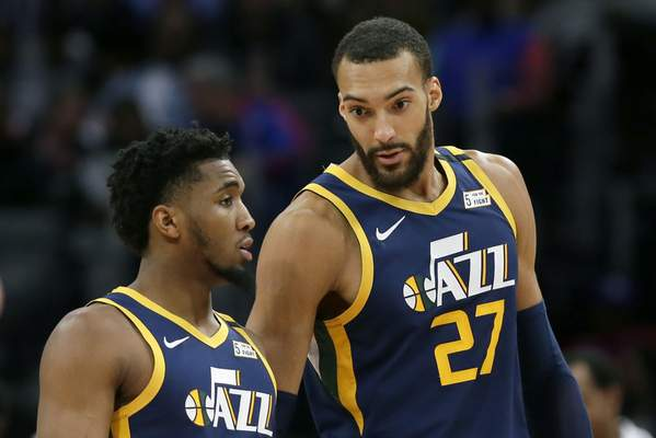 Associated Press Jazz teammates Rudy Gobert, right, and Donovan Mitchell tested positive for COVID-19.