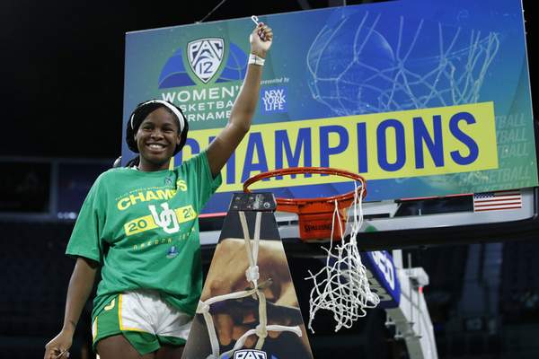 Oregon's Ruthy Hebard reacts while cutting down the net after defeating Stanford in an NCAA college basketball game in the final of the Pac-12 women's tournament Sunday, March 8, 2020, in Las Vegas. (AP Photo/John Locher)