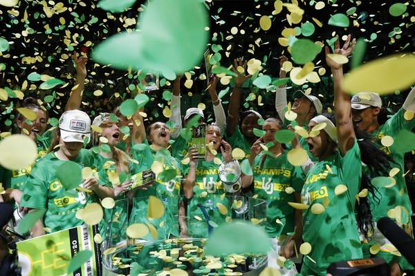 Oregon players celebrate after defeating Stanford in an NCAA college basketball game in the final of the Pac-12 women's tournament Sunday, March 8, 2020, in Las Vegas. (AP Photo/John Locher)