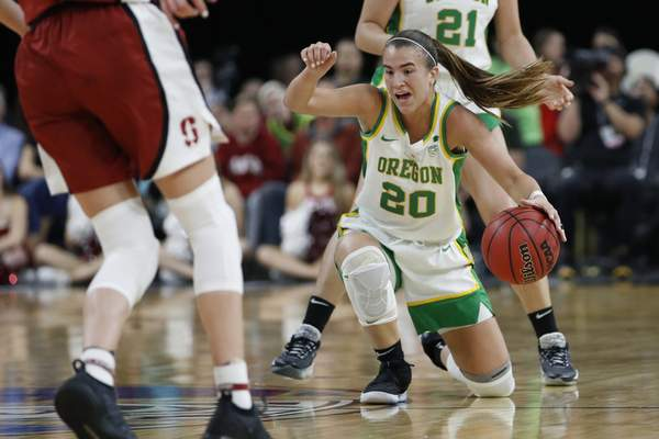 Oregon's Sabrina Ionescu (20) dribbles the ball against Stanford during the second half of an NCAA college basketball game in the final of the Pac-12 women's tournament Sunday, March 8, 2020, in Las Vegas. (AP Photo/John Locher)