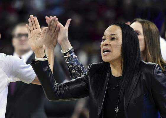 FILE - In this Feb. 17, 2020, file photo, South Carolina coach Dawn Staley high fives players before an NCAA college basketball game against Vanderbilt, in Columbia, S.C. South Carolina is No. 1 in the final Associated Press women's basketball poll of the season for the first time in school history. (AP Photo/Sean Rayford, File)