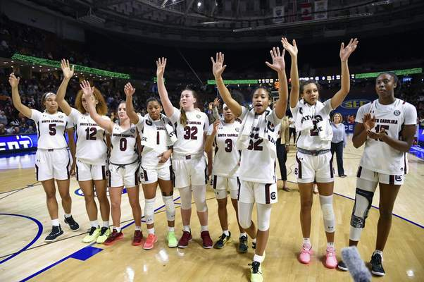 FILE - In this March 6, 2020, file photo, South Carolina players celebrate after defeating Georgia 89-56 in a quarterfinal match at the Southeastern women's NCAA college basketball tournament in Greenville, S.C. South Carolina is No. 1 in the final Associated Press women's basketball poll of the season for the first time in school history. (AP Photo/Richard Shiro, File)