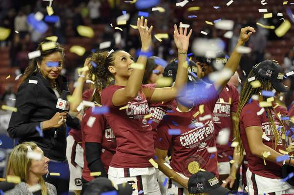 South Carolina's Mikiah Herbert-Harrigan grabs for confetti after defeating Mississippi State in a championship match at the Southeastern Conference women's NCAA college basketball tournament in Greenville, S.C., Sunday, March 8, 2020. (AP Photo/Richard Shiro)