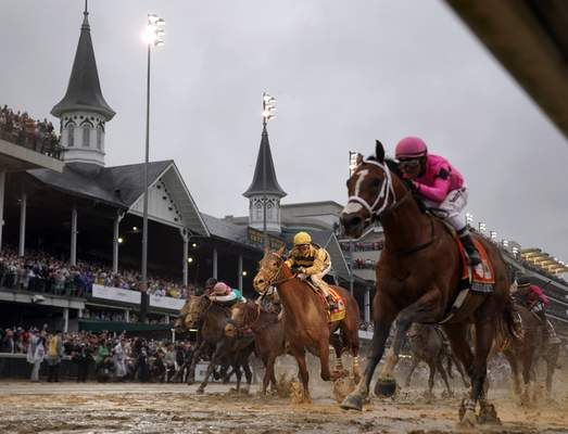 FILE - In this May 4, 2019, file photo, Luis Saez rides Maximum Security, right, across the finish line first against Flavien Prat on Country House during the 145th running of the Kentucky Derby horse race at Churchill Downs in Louisville, Ky.  (AP Photo/Matt Slocum, File)