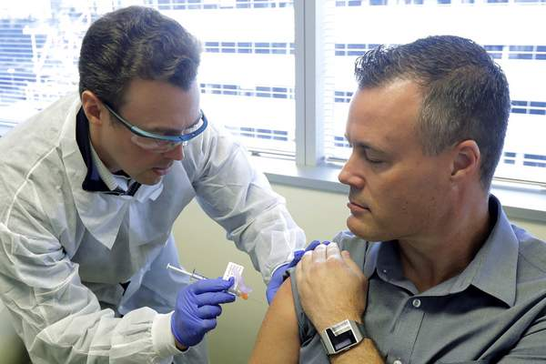 Volunteers Fight Virus By Testing New Experimental Vaccine