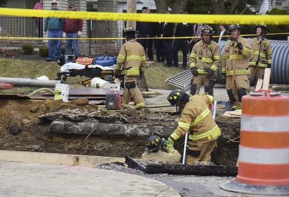 Katie Fyfe | The Journal Gazette  A worker was killed Tuesday afternoon after being buried under gravel near Franklin Avenue and Huffman Street.