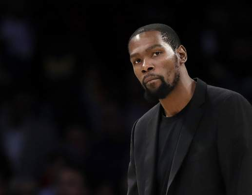 Durant FILE- In this March 10, 2020, file photo, Brooklyn Nets' Kevin Durant watches during the second half of the team's NBA basketball game against the Los Angeles Lakers in Los Angeles. Durant is among the four Brooklyn Nets who have tested positive for the new coronavirus. (AP Photo/Marcio Jose Sanchez, file)