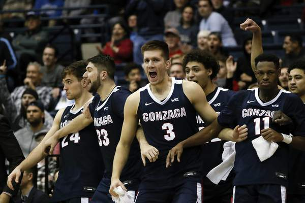 FILE - In this Jan. 9, 2020, file photo, Gonzaga forward Filip Petrusev (3) celebrates with teammates during the second half of an NCAA college basketball game against San Diego, in San Diego. (AP Photo/Gregory Bull, File)