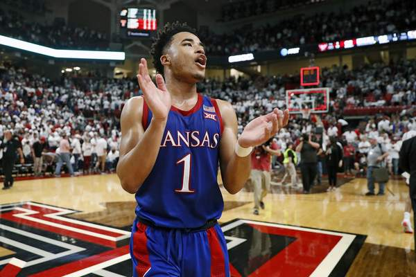 FILE - In this March 7, 2020, file photo, Kansas' Devon Dotson (1) celebrates after an NCAA college basketball game against Texas Tech in Lubbock, Texas. (AP Photo/Brad Tollefson, FIle)