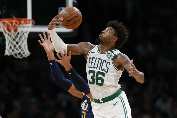 Boston Celtics' Marcus Smart (36) gathers in a rebound against the Utah Jazz during the fourth quarter of an NBA basketball game Friday, March 6, 2020, in Boston. (AP Photo/Winslow Townson)