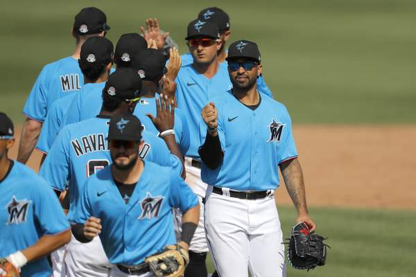 Miami Marlins' Matt Kemp, right, greets teammates after a spring training baseball game against the Washington Nationals, Tuesday, March 10, 2020, in Jupiter, Fla. (AP Photo/Julio Cortez)