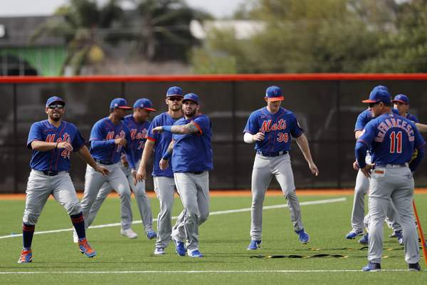 Members of the New York Mets warm up during spring training baseball practice Saturday, Feb. 15, 2020, in Port St. Lucie, Fla. (AP Photo/Jeff Roberson)