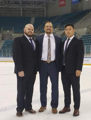 Courtesy  Former Komets coach Gary Graham, middle, with another native of Fort Wayne, Brian Gratz, left, coached ORG Beijing this season along with Guan Wang, right.