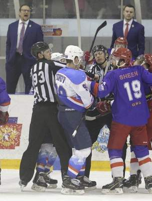 Courtesy  Former Komets coach Gary Graham, top left, watches as his ORG Beijing teams gets in a fracas this season.