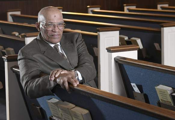 Associated Press The Rev. Alvin Gwynn Sr. of Friendship Baptist Church in Baltimore bucked the cancellation trend by holding services the previous Sunday.