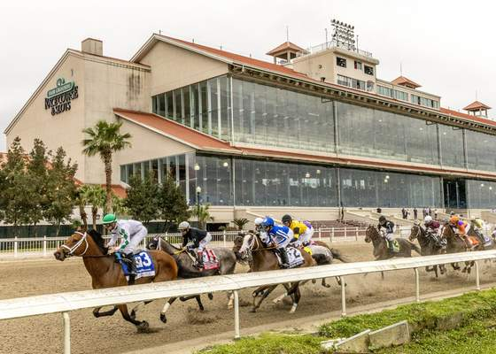 Associated Press Wells Bayou, left, ridden by jockey Florent Geroux, led wire-to-wire  to win he 107th running of the $1,000,000 Grade II Louisiana Derby, a major prep race for the Kentucky Derby, on Saturday