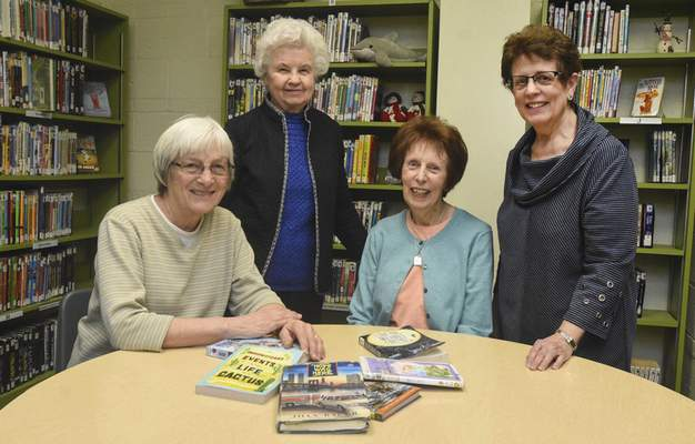 Photos by Michelle Davies | The Journal Gazette Retired teachers, from left, JoAnn Wudy, Shirley Kern,  Sally Birkey and Linda Williams continue to educate by guiding Emmanuel-St. Michael Lutheran School's accelerated reading program.