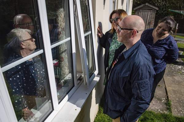 Associated Press Olive Trotman, left, is visited by son Mark, his wife, Denise, and his sister Kelly in Napton, England, on Sunday, which wasMother's Day in Great Britain.