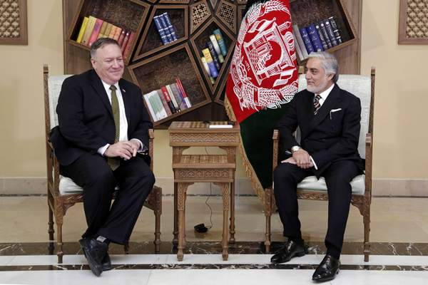 U.S. Secretary of State Mike Pompeo, left, meets with Abdullah Abdullah the main political rival of President Ashraf Ghani at the Sepidar Palace, in Kabul, Afghanistan, Monday, March 23, 2020. Pompeo was in Kabul on an urgent visit Monday to try to move forward a U.S. peace deal signed last month with the Taliban, a trip that comes despite the coronavirus pandemic, at a time when world leaders and statesmen are curtailing official travel. (Sepidar Palace via AP)