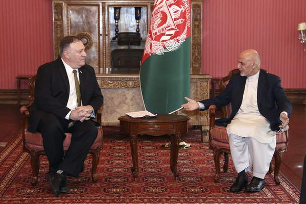 U.S. Secretary of State Mike Pompeo, left, meets with Afghan President Ashraf Ghani, at the Presidential Palace in Kabul, Afghanistan, Monday, March 23, 2020. Pompeo was in Kabul on an urgent visit Monday to try to move forward a U.S. peace deal signed last month with the Taliban, a trip that comes despite the coronavirus pandemic, at a time when world leaders and statesmen are curtailing official travel. (Afghan Presidential Palace via AP)