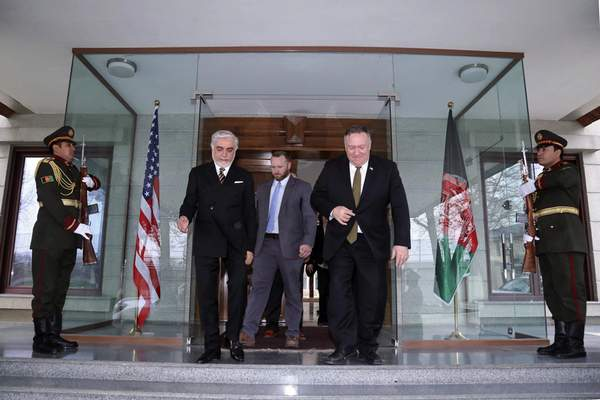 U.S. Secretary of State Mike Pompeo, center right, and Abdullah Abdullah the main political rival of President Ashraf Ghani, center left, walk at the Sepidar palace, in Kabul, Afghanistan, Monday, March 23, 2020. Pompeo was in Kabul on an urgent visit Monday to try to move forward a U.S. peace deal signed last month with the Taliban, a trip that comes despite the coronavirus pandemic, at a time when world leaders and statesmen are curtailing official travel. (Sepidar palace via AP)