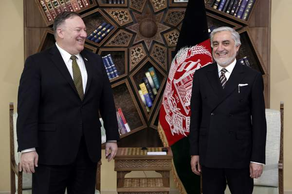 U.S. Secretary of State Mike Pompeo, left, stands with Abdullah Abdullah the main political rival of President Ashraf Ghani at the Sepidar Palace, in Kabul, Afghanistan, Monday, March 23, 2020. Pompeo was in Kabul on an urgent visit Monday to try to move forward a U.S. peace deal signed last month with the Taliban, a trip that comes despite the coronavirus pandemic, at a time when world leaders and statesmen are curtailing official travel. (Sepidar palace via AP)