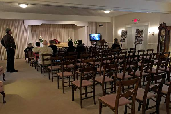 This March 18, 2020, photo shows a funeral that was affected by new rules put in place due to the coronavirus outbreak in Milwaukee. Wisconsin Gov. Tony Evers restricted gatherings to less than 10 people the day before. (AP Photo/Carrie Antlfinger)