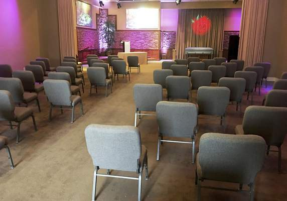 This March 19, 2020 photo provided by Bob Arrington of Arrington Funeral Directors shows a viewing room with seating arranged to facilitate social distancing amid the coronavirus outbreak, at their funeral home in Jackson, Tenn. (Cliff Walker Jr./Arrington Funeral Directors via AP)
