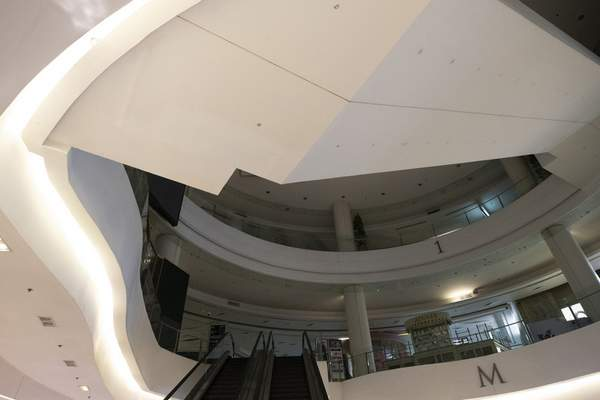 A shopping mall is empty in Bangkok, Thailand, Monday, March 23, 2020. (AP Photo/Sakchai Lalit)