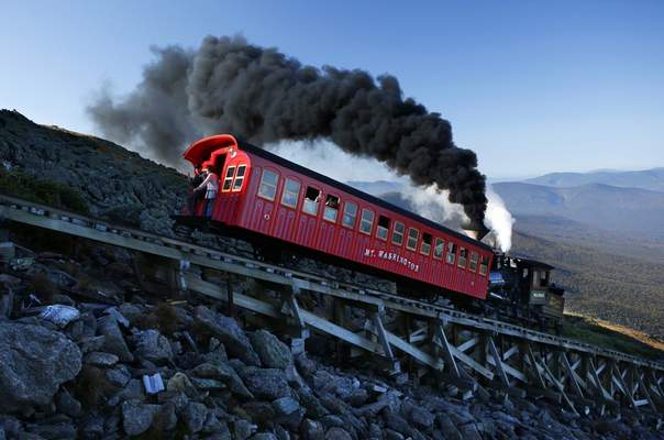 Associated Press The Cog Railway train helped rescue an injured hiker Sunday who fell about 200 feet while descending Mount Washington in New Hampshire. The steam-powered train pushes passenger cars full of tourists up and down the 6,288-foot mountain.