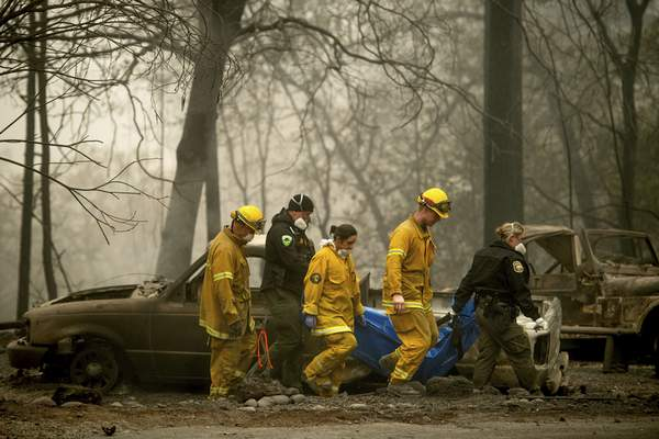 Associated Press  Firefighters and deputies carry the body of a Camp Fire victim in Paradise, Calif., in 2018. Pacific Gas & Electric will plead guilty to 84 counts of involuntary manslaughter in connection with the wildfire.