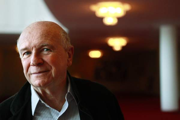 FILE - In this April 1, 1010, file photo, playwright Terrence McNally poses at the Kennedy Center in Washington. McNally, one of America's great playwrights whose prolific career included winning Tony Awards for the plays Love! Valour! Compassion! and Master Class and the musicals Ragtime and Kiss of the Spider Woman, died Tuesday, March 24, 2020, of complications from the coronavirus. He was 81. (AP Photo/Jacquelyn Martin, File)