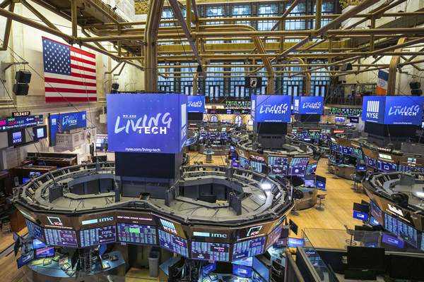 This photo provided by the New York Stock Exchange shows the unoccupied NYSE trading floor, closed temporarily for the first time in 228 years as a result of coronavirus concerns, Tuesday March 24, 2020. (Kearney Ferguson/NYSE via AP)