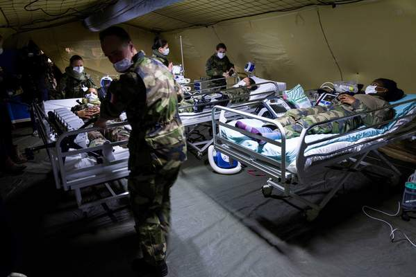 French soldiers takes part in a training session at the military field hospital in Mulhouse, eastern France, Tuesday March 24, 2020. (Sebastien Bozon, Pool via AP)