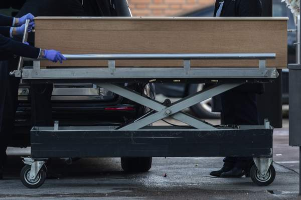 Undertakers carry a coffin of a person who died of COVID-19 at the La Almudena cemetery in Madrid, Spain, Monday, March 23, 2020. (AP Photo/Bernat Armangue)