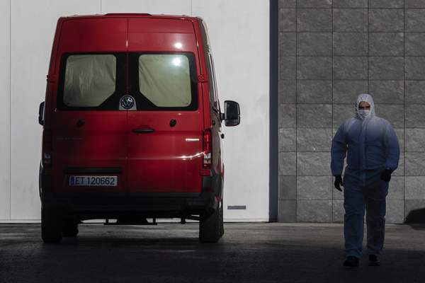 A spanish UME (Emergency Army Unit) soldier walks out of Madrid's ice rink turned into a temporary morgue due the COVID-19 crisis in Madrid, Spain, Monday, March 23, 2020. (AP Photo/Bernat Armangue)