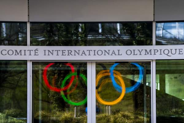 The Olympic Rings are displayed at the entrance of the IOC, International Olympic Committee headquarters during the coronavirus disease (COVID-19) outbreak in Lausanne, Switzerland, Tuesday, March 24, 2020. (Jean-Christophe Bott/Keystone via AP)