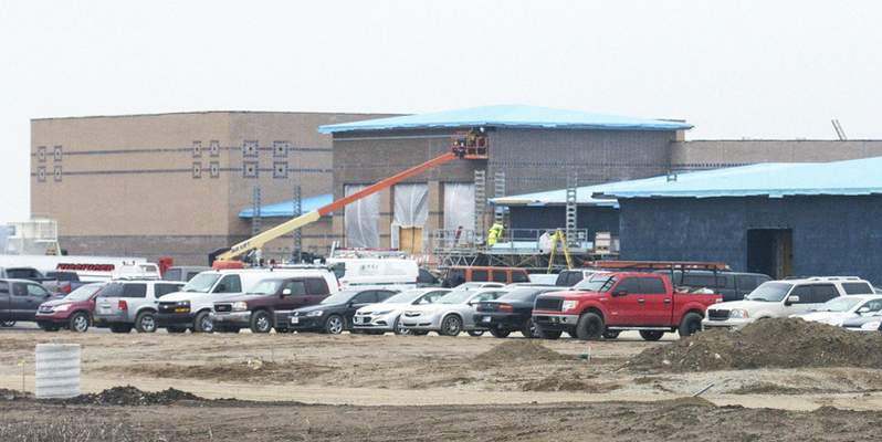 Michelle Davies | The Journal Gazette Work continues on Aspen Meadow Elementary School on Hathaway Road, the newest elementary in the Northwest Allen County Schools district. The school won't be ready for students in August.