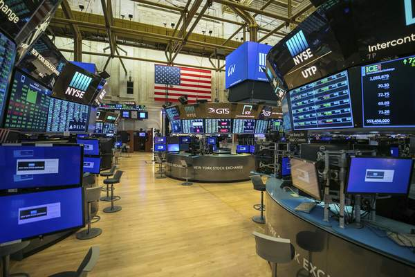 Associated Press The floor of the New York Stock Exchange is shown unoccupied Tuesday. It is closed temporarily for the first time in 228years as a result of coronavirus concerns.