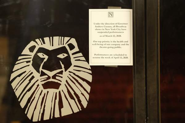 A sign announcing the suspension of all Broadway shows is posted on a door at the Minskoff Theatre, where The Lion King had been playing, Thursday, March 12, 2020, in New York. Gov. Andrew Cuomo banned gatherings of more than 500 people. (AP Photo/Kathy Willens)