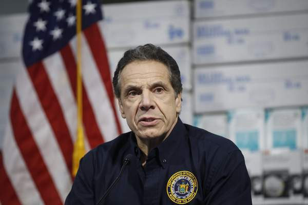 New York Gov. Andrew Cuomo speaks during a news conference against a backdrop of medical supplies at the Jacob Javits Center that will house a temporary hospital in response to the COVID-19 outbreak, Tuesday, March 24, 2020, in New York. (AP Photo/John Minchillo)